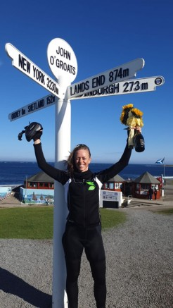 Clare Bull celebrates in John O'Groats after completing her epic cycle ride