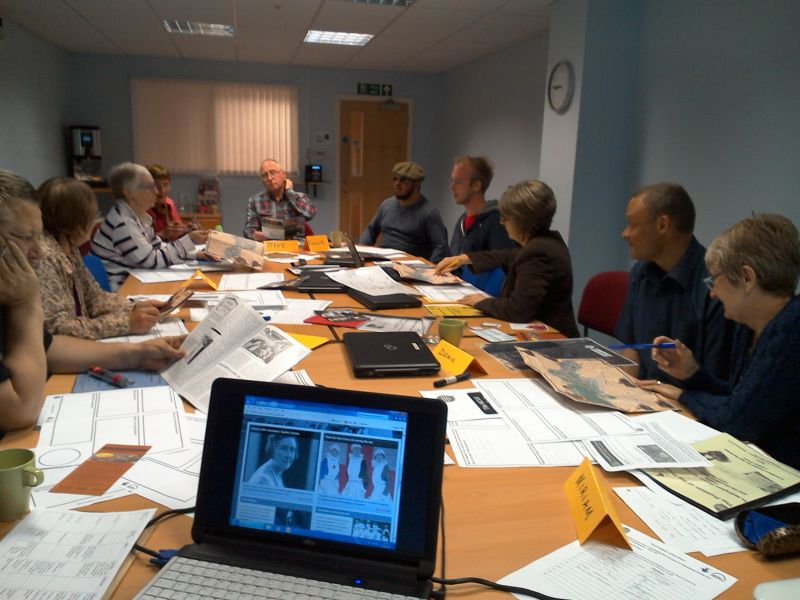 Volunteers discussing heritage documents
